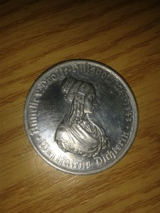 coin with woman
