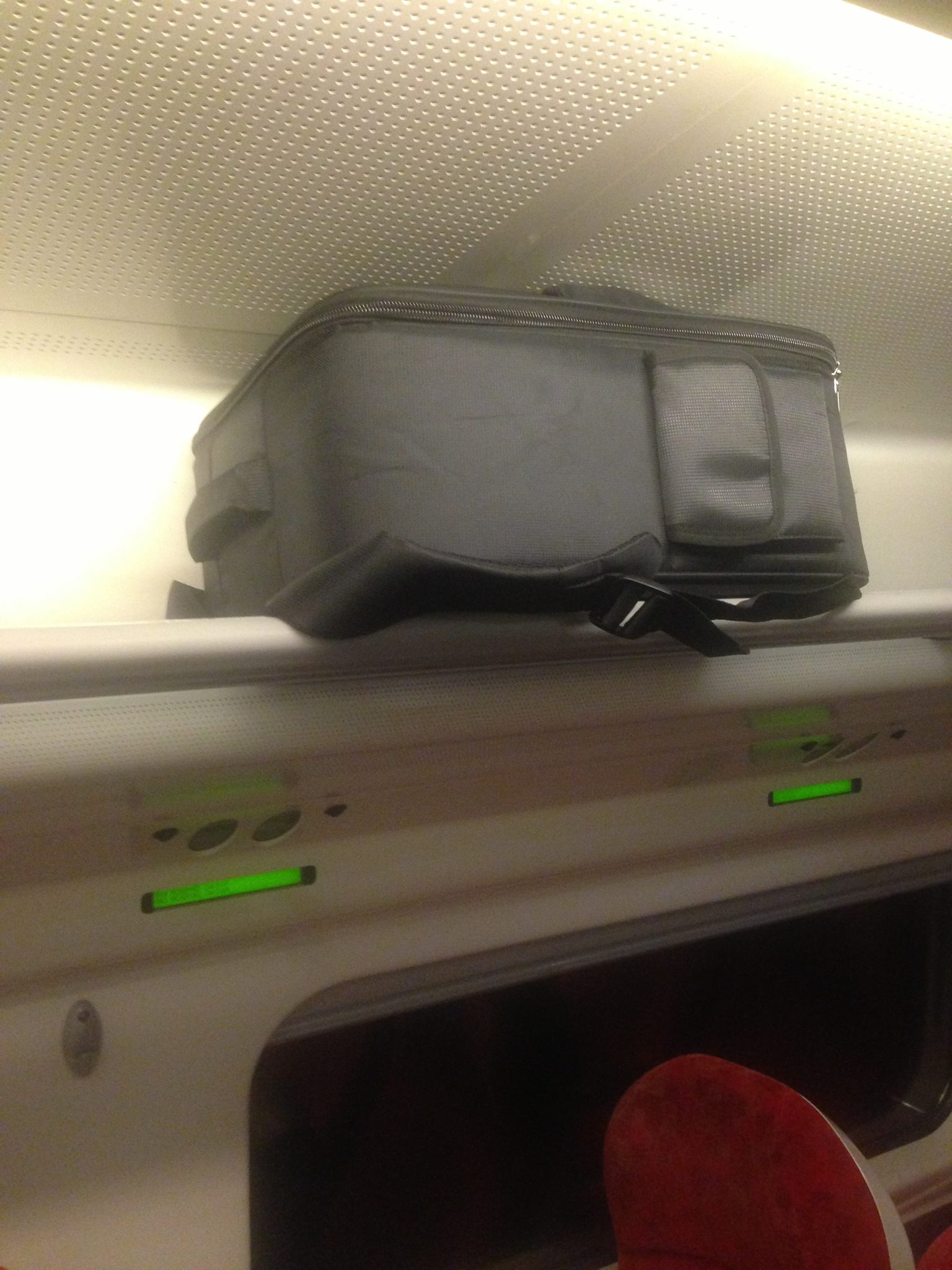 Drone in backpack on the train