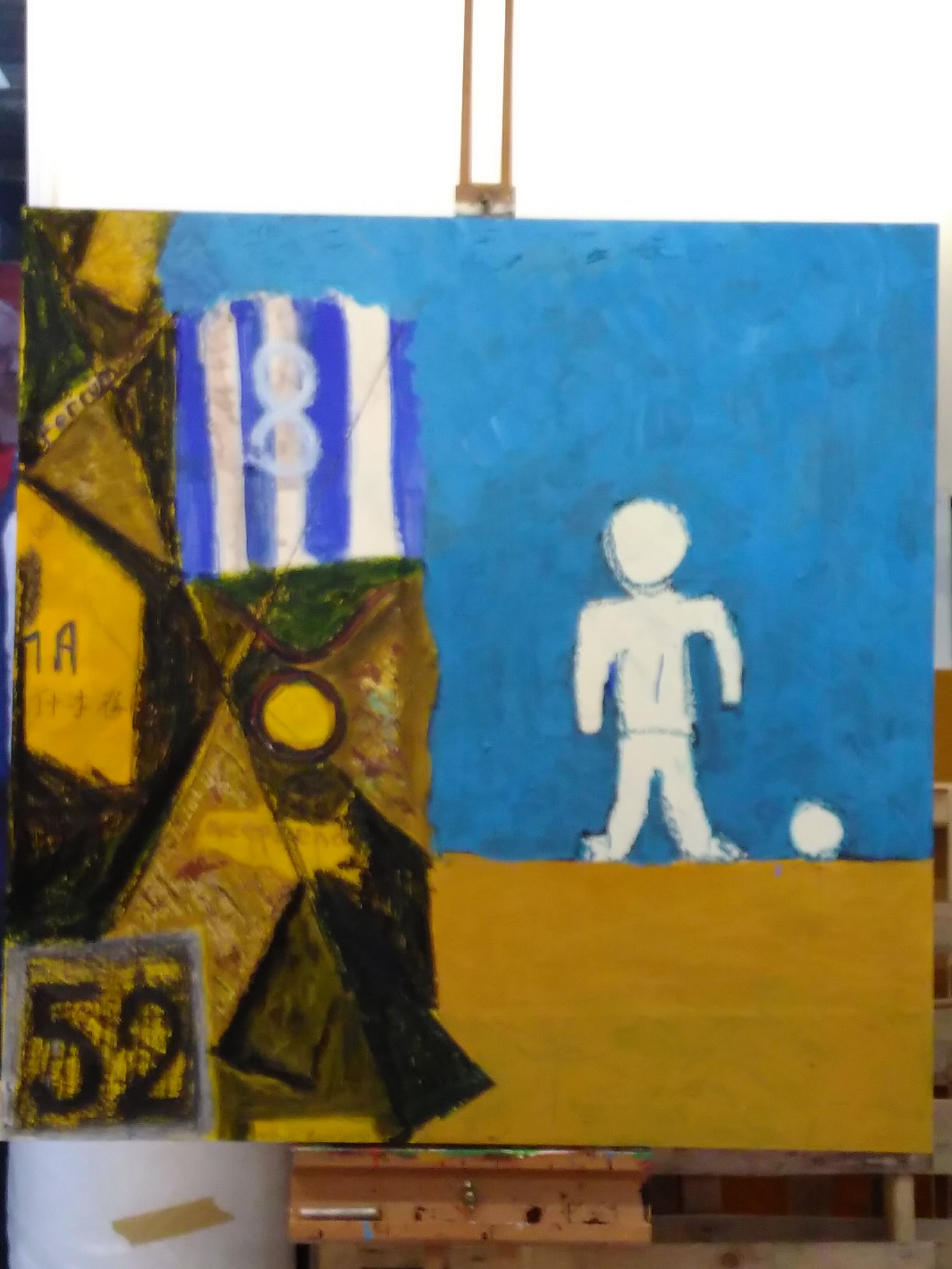 A painting which shows on the right, a white figure against a blue background, and on the left, a collage of scraps.