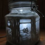 glass kilner jar with moonlight image of boat sailing on the waves